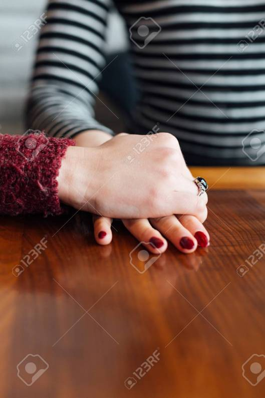 Couple at a table holding hands